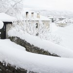 Snow has covered all houses, fences, treks of this traditional village in North-Western Greece