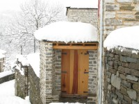 The entrance to an old traditional stone house in the Zagori in Pindus mountain range