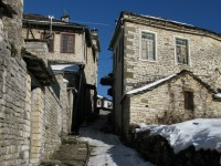 A partly covered with snow cobble path in one of the stone villages of Zagorochoria in Epirus
