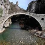 """""""Kokkoros bridge"""", the single arch stone bridge close to the villages of Koukouli and Kipoi in Zagori, Epirusou-arched-bridge"""