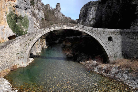 """Kokkoros bridge"", the single arch stone bridge close to the villages of Koukouli and Kipoi in Zagori, Epirusou-arched-bridge"
