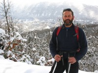 Manolis Diamantopoulos on a snow racket walk in the snowy landscape of the Zagori area in Pindus mountains