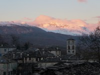 Winter has fallen upon a traditional stone village of the National Park of Vikos-Aoos