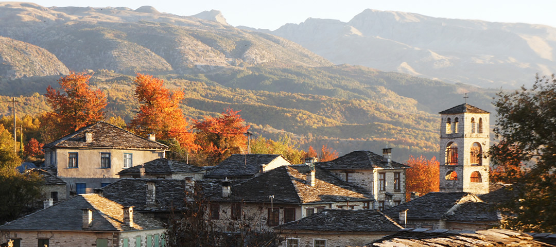 Fall season in the region of Zagori (Zagorochoria). Beautiful villages with stone houses, paths, bridges