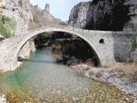 Kokkoros single arch stone bridge. The stone arched bridges were built by benefactions from expatriate merchants in the 18th century and replaced older wooden bridges