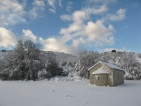 A snow capped church close to the village Kato Pedina in the Zagori district in Northern Greece