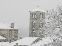 The church tower with snow. New Year''s eve 2013, Zagori, Greece
