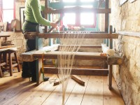 Setting up the shaft frames and heddles of the loom in Kato Pedina village in Zagorochoria, Greece
