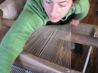 Setting up the weft in the old traditional loom in Greece