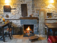 The fireplace in the main sitting area of the Jazz bar-restaurant Anemi in Epirus, Greece