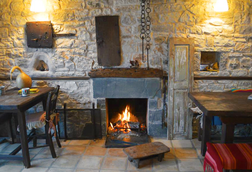 The fireplace in the main sitting area of the Jazz bar-restaurant Anemi in Pindus, Epirus, Greece