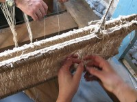 Setting up the warp of the loom