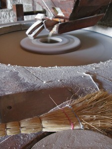 Grinding grain (corn or wheat) into flour in the water mills in Kalpaki village of Epirus