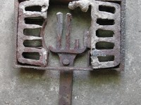 The half melted grate within the wood stove