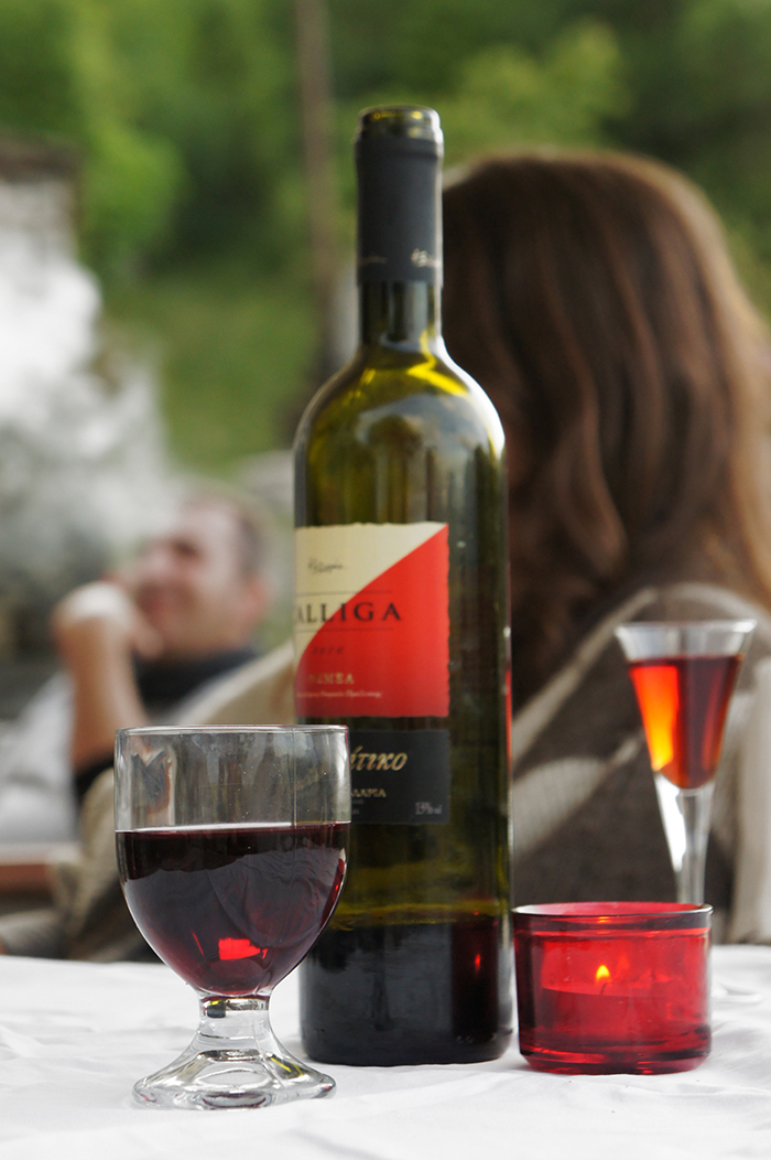 Enjoying the sunset with a glass of wine at Lithos restaurant in Central Zagori