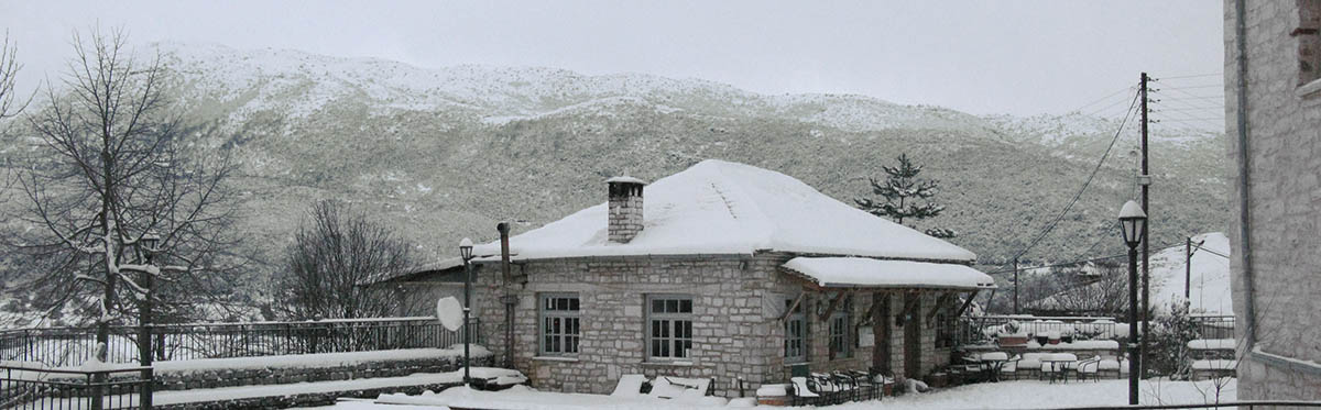 Winter time in the village of Kato Pedina or Soudena as was the name in the past and the cafe-taverna in the village square