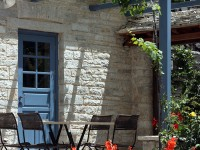 The yard in front of the restaurant of the traditional Inn-Hotel in Zagori amidst spring flowers