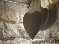 Heart shaped cheeses are being drained hanging from the traditional ceiling of Anemi guesthouse in Zagorohoria, Pindus