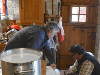 The fresh sheep milk is poured by Basilis Paparounas and Paulos Sakkas of Anemi hotel in Zagori into the cheese vat to initiate the cheese making process