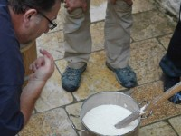 An impatient guest tastes the milk at Anemi restaurant in Zagorohoria during the cheese making seminar