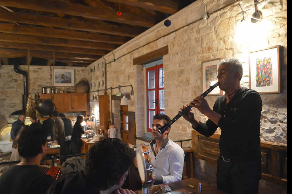 During the cheese making sessions musicians from the nearby village of Parakalamos arrived at the and turned the seminars into a cheese-music happening