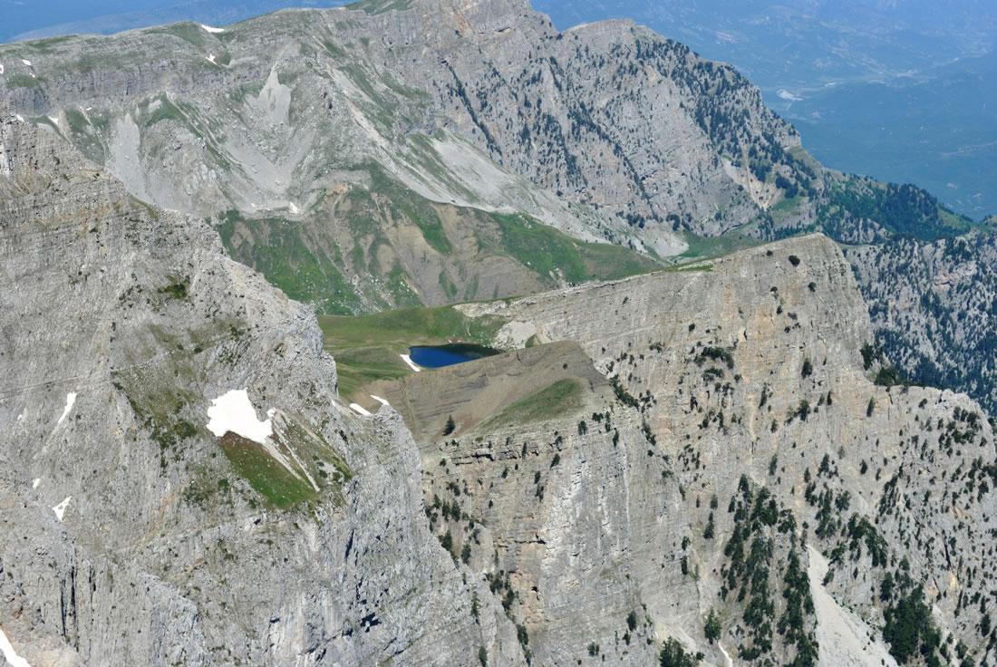 Birds view of the Dragon lake on Gamila peak Mt. Tymfi in Vikos-Aoos Geopark in Greece