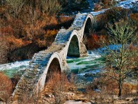 "The stone arched bridge of ""Plakidas"" close to Kipi village"