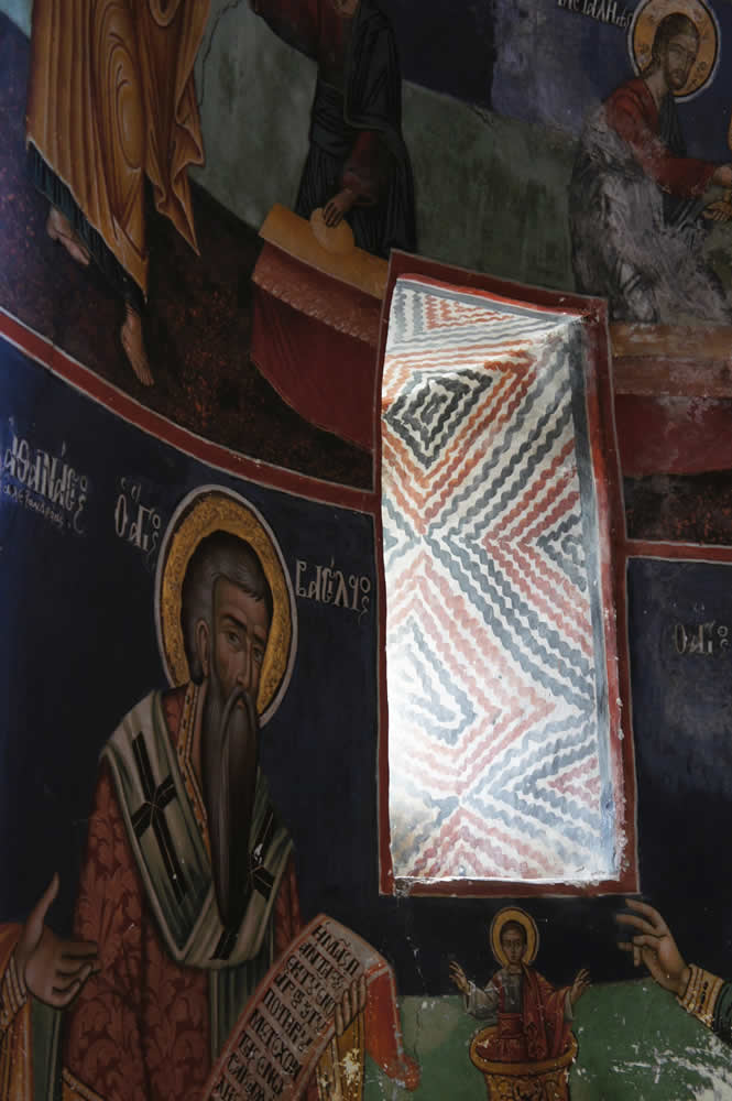 The narrow window behind the Holy altar of St. George Byzantine church in Negades, Epirus, Greece