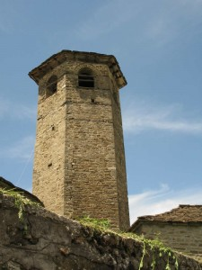 The churche's bell tower has a hexagonal katopsis, with arched openings in the upper part, and is located in the northeast part of the church at a short distance from the temple