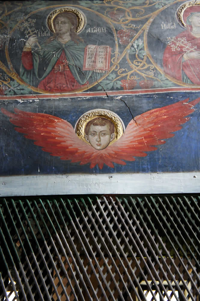 A trellis with an angel above separating the gynaeceum from the main church of St. George in Negades, Zagorohoria
