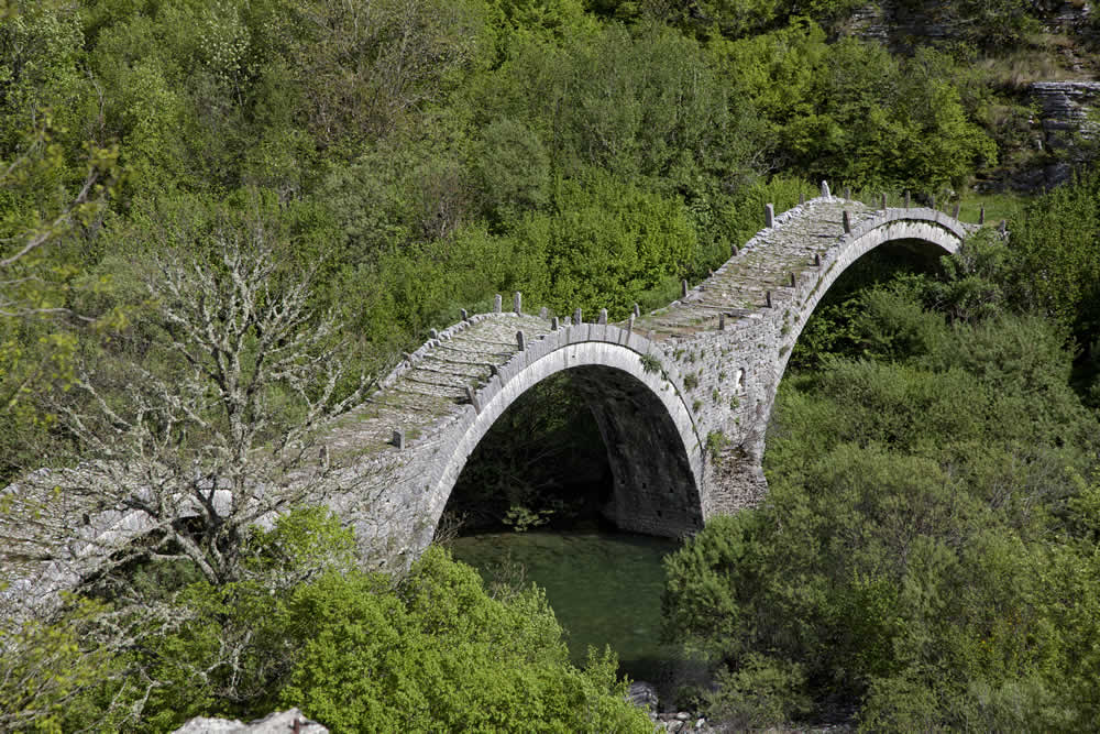 three arched traditional stone bridge zagori