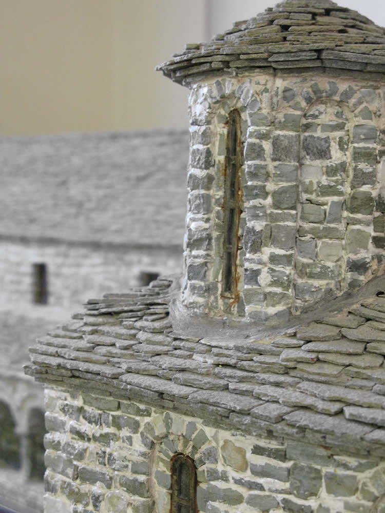 Detail of a scale model church made of stone in the traditional way the original was made