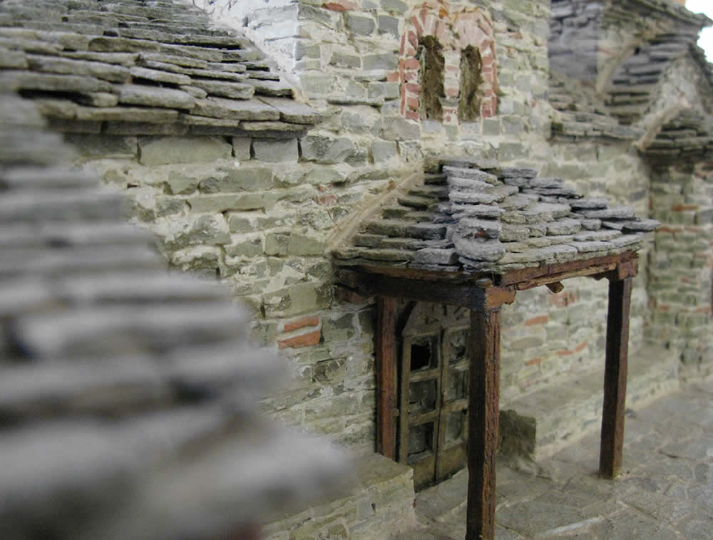 Detail of a scale model house made of stone in the traditional way the original was made