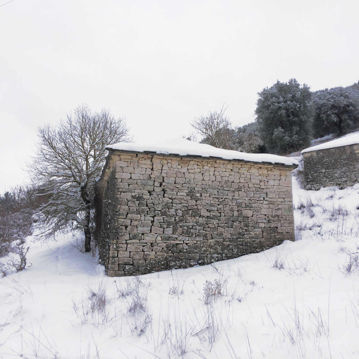 An old snow-covered stone building, Kato Pedina village, Zagori
