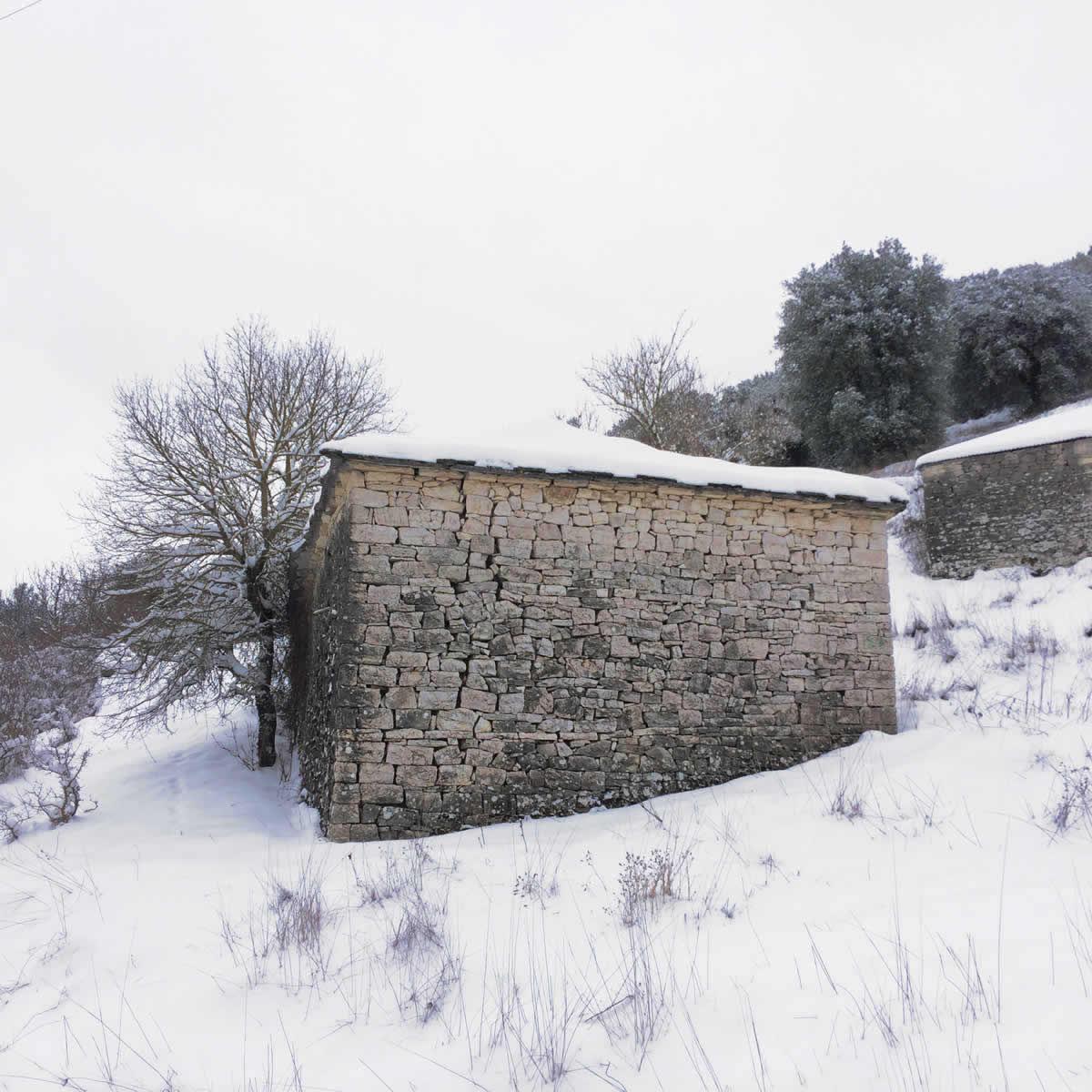 An old snow-covered stone building, Kato Pedina village, Zagori