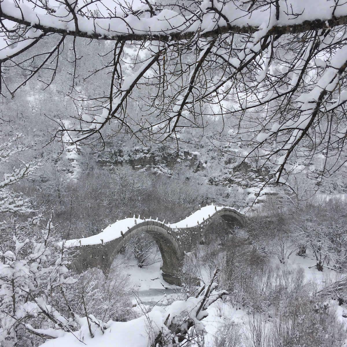 Tritoxo triple arch traditional stone bridge in Zagori between Kipoi and Koukouli villages
