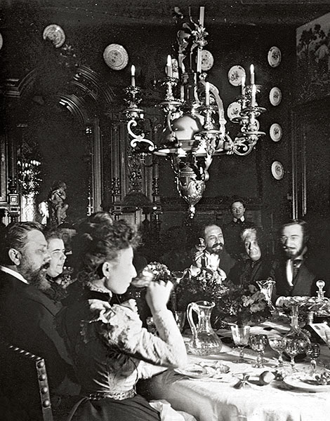 At the Zollikofer residence in Nancy, circa 1901. Nissim and his friends and other banqueters enjoy a lavish dinner and amuse themselves with poems, music and wide-ranging conversations