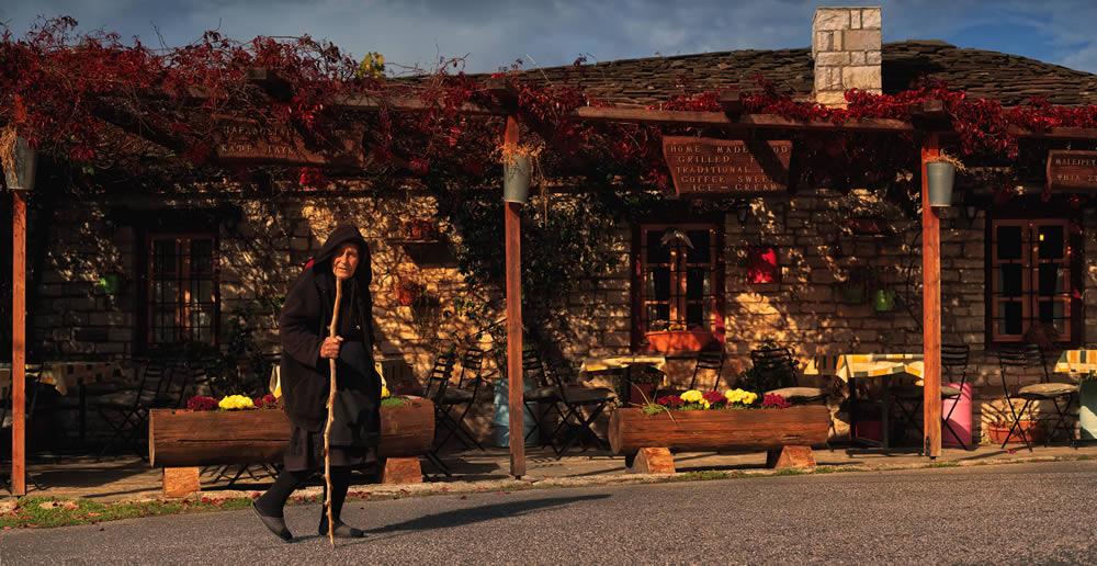 Old lady walking in Vikos village, Zagori | Alexandros Malapetsas